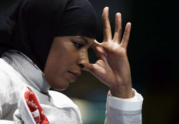 Ibtihaj Muhammad of the United States reacts after losing against Cecilia Berder of France in the women's individual saber fencing event at the 2016 Summer Olympics in Rio de Janeiro, Brazil, Monday, Aug. 8, 2016. (AP Photo/Andrew Medichini)