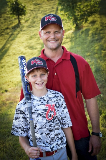 This June 2016 photo provided by David Strickland shows Caleb Thomas Schwab posing with his father Scott Schwab, a Kansas state lawmaker from Olathe. Caleb died Sunday, Aug. 7, 2016, while riding the Verruckt, a water slide that's billed as the world's largest, at the Schlitterbahn Waterpark in Kansas City, Kan. (David Strickland/David Strickland via AP)