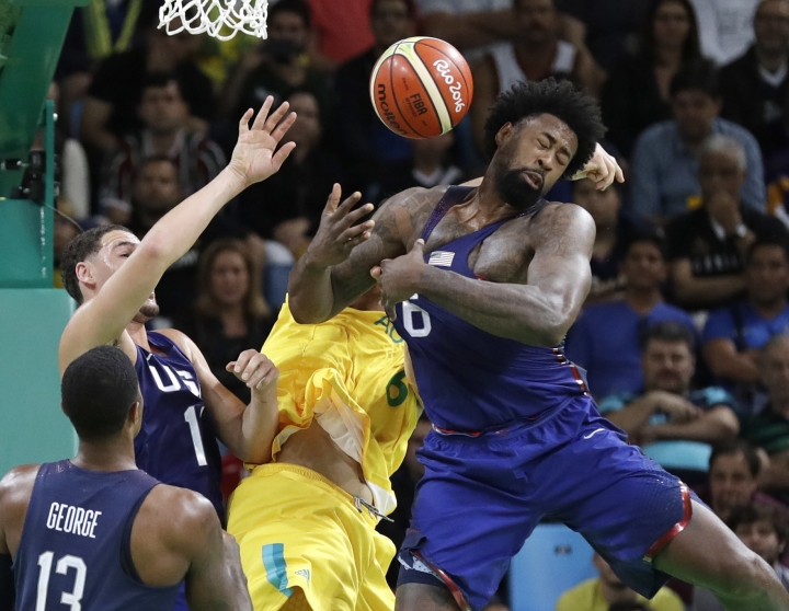 Australia's Andrew Bogut, center, United States' DeAndre Jordan (6) and United States' Klay Thompson (11) scramble for a rebound during a men's basketball game at the 2016 Summer Olympics in Rio de Janeiro, Brazil, Wednesday, Aug. 10, 2016. (AP Photo/Eric Gay)