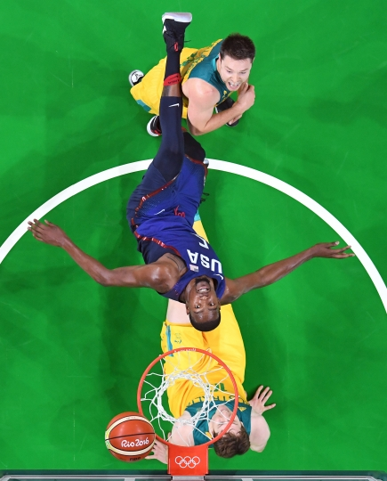United States' Kevin Durant, center, watches his shot over Australia's Cameron Bairstow (10) and Matthew Dellavedova, top, during a men's basketball game at the 2016 Summer Olympics in Rio de Janeiro, Brazil, Wednesday, Aug. 10, 2016. (Mark Ralston/Pool Photo via AP)