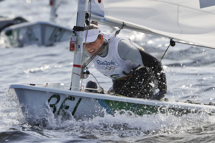 In this picture taken Tuesday, Aug. 9, 2016, Belgium's Evi Van Acker competes during the Laser Radial women event at the 2016 Summer Olympics in Rio de Janeiro, Brazil. Van Acker reported feeling sick after races Wednesday, Aug. 10, the governing body World Sailing said. (AP Photo/Gregorio Borgia)