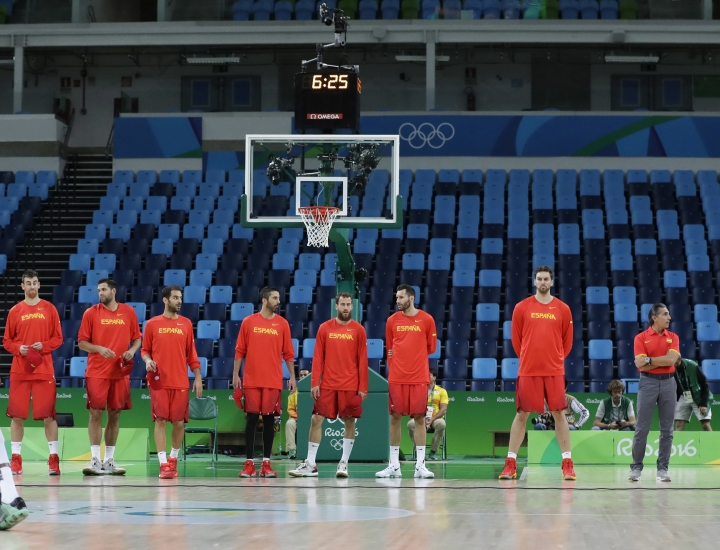 The Spain basketball team lines up for introductions with empty stands due to a controlled explosion at a men's basketball game at the 2016 Summer Olympics in Rio de Janeiro, Brazil, Thursday, Aug. 11, 2016. (AP Photo/Eric Gay)