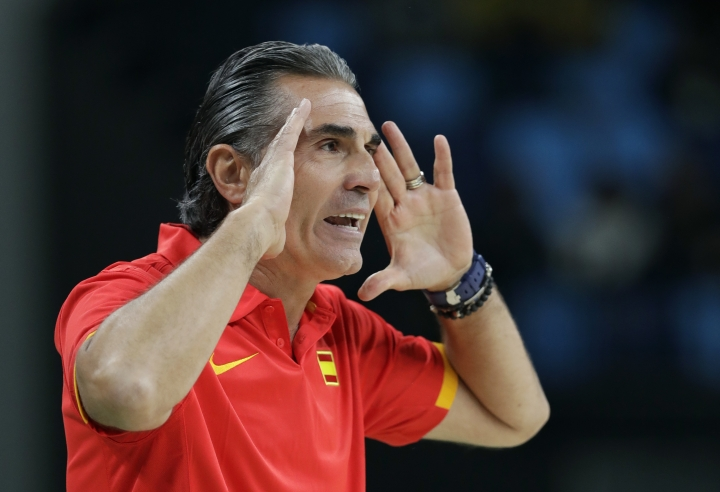 Spain head coach Sergio Scariolo directs his team during a basketball game against Nigeria at the 2016 Summer Olympics in Rio de Janeiro, Brazil, Thursday, Aug. 11, 2016. (AP Photo/Charlie Neibergall)
