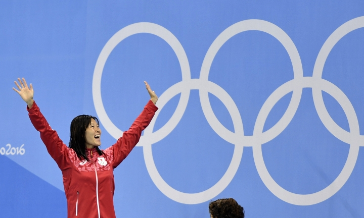 Japan's Rie Kaneto celebrates on the podium after winning the gold medal in the women's 200-meter breaststroke final during the swimming competitions at the 2016 Summer Olympics, Thursday, Aug. 11, 2016, in Rio de Janeiro, Brazil. (AP Photo/Martin Meissner)