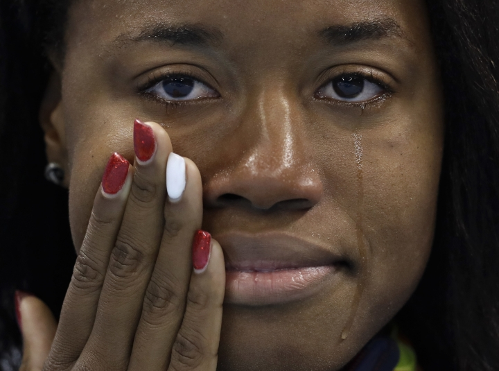 United States' gold medal winner Simone Manuel cries during the medal ceremony for the women's 100-meter freestyle final during the swimming competitions at the 2016 Summer Olympics, Friday, Aug. 12, 2016, in Rio de Janeiro, Brazil. (AP Photo/Michael Sohn)