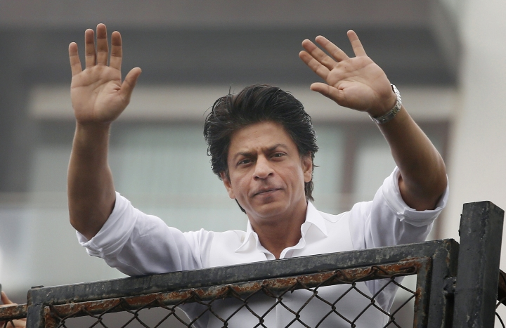 "FILE - In this Thursday, July 7, 2016, file photo, Bollywood actor Shah Rukh Khan greets fans waiting outside his residence on Eid al-Fitr in Mumbai, India. Bollywood superstar Khan has tweeted that he gets detained at U.S. airports ""every damn time"" after he was stopped at the Los Angeles International Airport. The U.S. Ambassador to New Delhi Richard R. Verma tweeted an apology to the star Friday, Aug. 12, saying that the government was working to ""to ensure it doesn't happen again."" (AP Photo/Rajanish Kakade, File )"