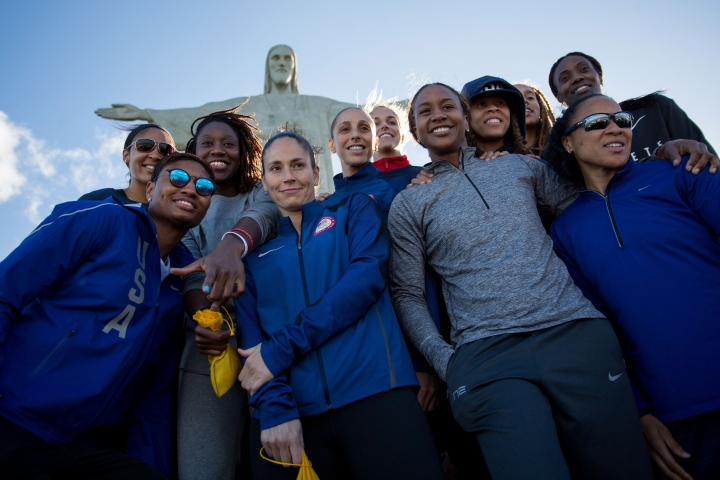 Members of the United States basketball women team pose for a photo at Christ the Redeemer statue during the 2016 Summer Olympics in Rio de Janeiro, Thursday, Aug.11, 2016. (AP Photo/Mauro Pimentel)
