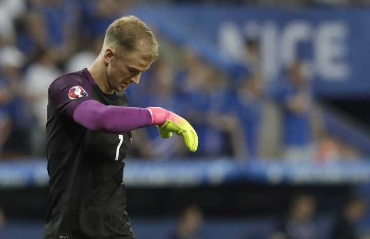 "FILE - In this Monday, June 27, 2016 file photo, England goalkeeper Joe Hart walks on the pitch during the Euro 2016 round of 16 soccer match between England and Iceland, at the Allianz Riviera stadium in Nice, France. Manchester City manager Pep Guardiola has cast doubt on whether goalkeeper Joe Hart remains part of the club's long-term plans. Asked how central Hart was to City on Friday, Aug. 12, Guardiola said he is happy with the England international's ""behavior and what he means to this club"" before adding ""after, we are going to decide inside the doors. (AP Photo/Pavel Golovkin, file)"