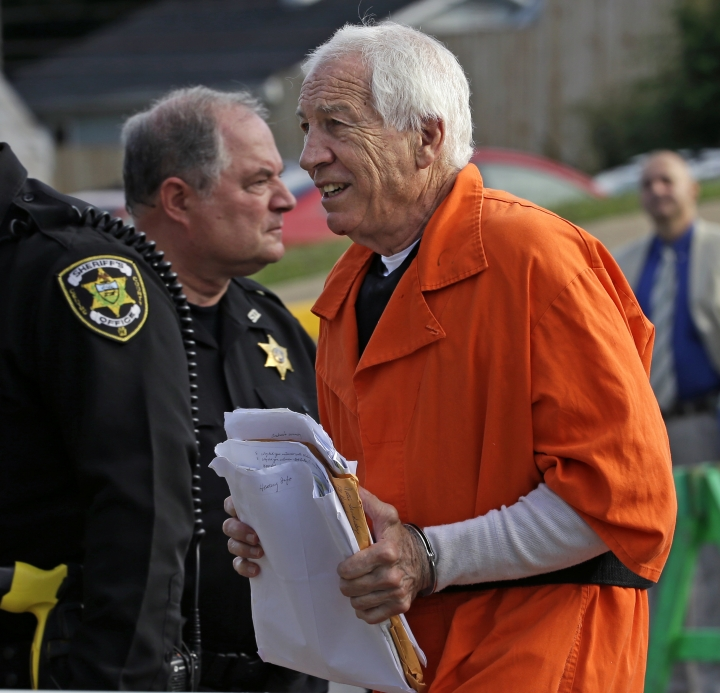 Former Penn State University assistant football coach Jerry Sandusky, right, arrives at the Centre County Courthouse for an appeals hearing about whether he was improperly convicted four years ago, in Bellefonte, Pa. Friday, Aug. 12, 2016. Sandusky is serving a 30- to 60-year sentence. (AP Photo/Gene J. Puskar)