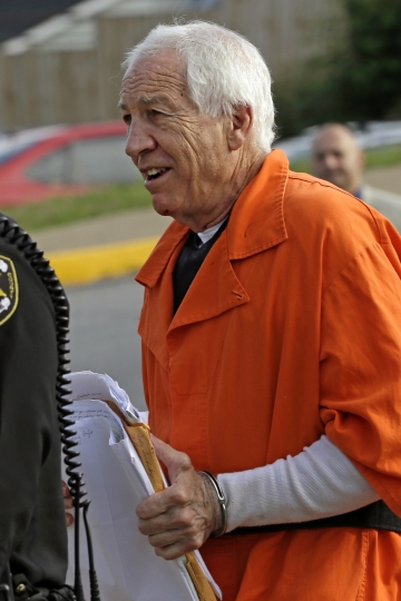 Former Penn State University assistant football coach Jerry Sandusky arrives at the Centre County Courthouse for an appeals hearing about whether he was improperly convicted four years ago, in Bellefonte, Pa. Friday, Aug. 12, 2016. Sandusky is serving a 30- to 60-year sentence. (AP Photo/Gene J. Puskar)