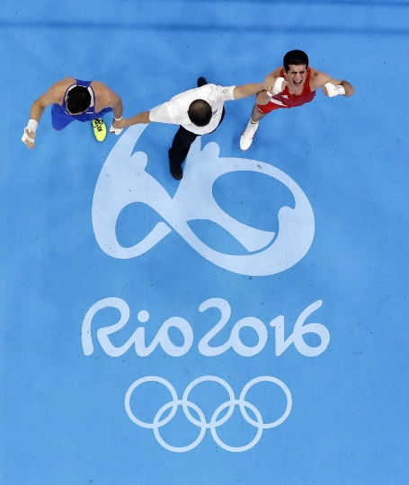 Azerbaijan's Kamran Shakhsuvarly, right, reacts as he won a match against Russia's Artem Chebotarev during a men's middleweight 75-kg preliminary boxing match at the 2016 Summer Olympics in Rio de Janeiro, Brazil, Friday, Aug. 12, 2016. (AP Photo/Frank Franklin II)