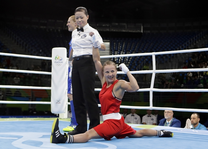 Ukraine's Tetyana Kob, right, celebrates as she won a match against Bulgaria's Stanmira Petrova during a women's flyweight 51-kg preliminary boxing match at at the 2016 Summer Olympics in Rio de Janeiro, Brazil, Friday, Aug. 12, 2016. (AP Photo/Frank Franklin II)