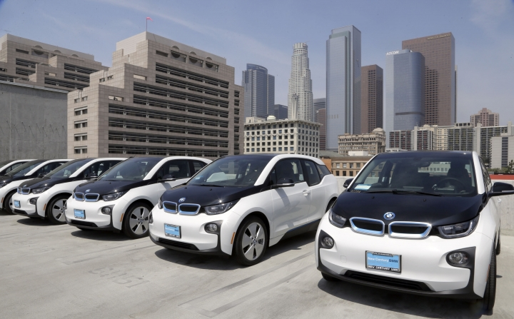 FILE - This June 8, 2016 file photo shows electric cars parked atop the Los Angeles Police Department parking lot, in Los Angeles. A California lawmaker told The Associated Press on Friday, Aug. 12, that she's introducing legislation to require that 15 percent of new vehicles be emission-free in less than a decade, a significant escalation in the state's efforts to speed the evolution of new car technology. (AP Photo/Nick Ut,File)