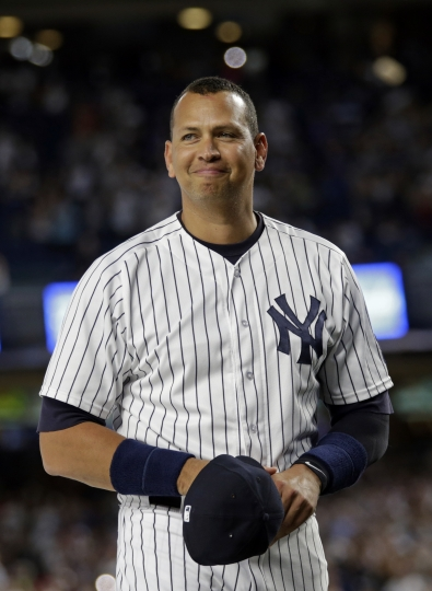 New York Yankees' Alex Rodriguez smiles during a ceremony prior to his final baseball game with the team, against the Tampa Bay Rays on Friday, Aug. 12, 2016, in New York. (AP Photo/Adam Hunger)