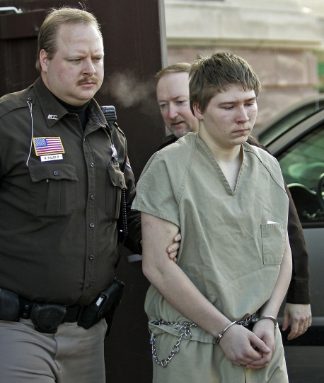 "FILE - In this Friday, March 3, 2006 photo, Brendan Dassey, 16, is escorted out of a Manitowoc County Circuit courtroom in Manitowoc, Wis. A federal court in Wisconsin on Friday overturned the conviction of Dassey, a man found guilty of helping his uncle kill Teresa Halbach in a case profiled in the Netflix documentary ""Making a Murderer."" (AP Photo/Morry Gash, File)"