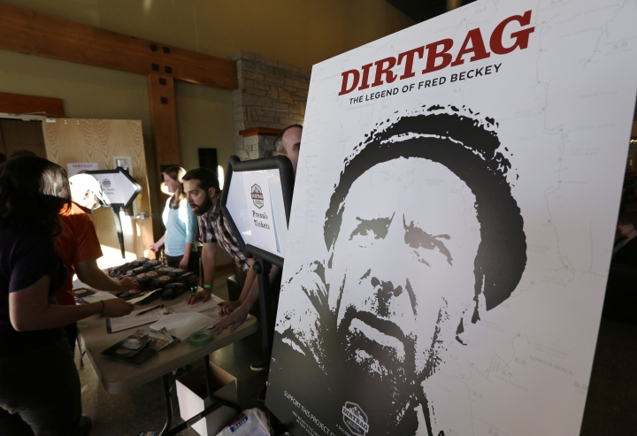 """In this photo taken July 26, 2016 in Seattle, a poster for """"Dirtbag: The Legend of Fred Beckey,"""" an upcoming documentary feature film about his life, is displayed at a promotional event for the film in Seattle. Beckey, 93, is the legendary mountain climber who has bagged more first ascents than any other mountaineer and wrote the definitive guidebooks to a major North American mountain range. (AP Photo/Ted S. Warren)"""