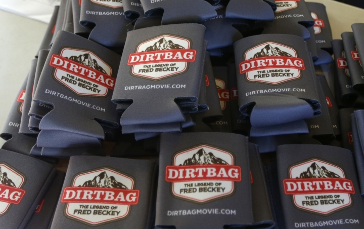 "In this photo taken July 26, 2016 in Seattle, souvenir insulated can holders with the logo for for the documentary feature, ""Dirtbag: The Legend of Fred Beckey,"" are stacked on a table at a promotional event for the film in Seattle. The film is about the life of Beckey, 93, the legendary mountain climber who has bagged more first ascents than any other mountaineer and wrote the definitive guidebooks to a major North American mountain range. (AP Photo/Ted S. Warren)"