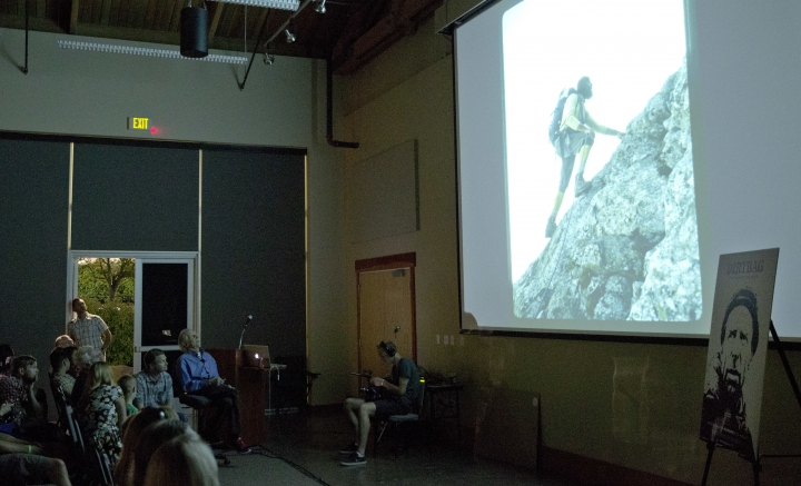 """In this photo taken July 26, 2016 in Seattle, Fred Beckey, second from right, the legendary mountain climber who has bagged more first ascents than any other mountaineer and wrote the definitive guidebooks to a major North American mountain range, narrates a personal slide show to a sold-out crowd at an event to kick-off a funding drive for """"Dirtbag: The Legend of Fred Beckey,"""" an upcoming documentary feature film about his life in Seattle. (AP Photo/Ted S. Warren)"""