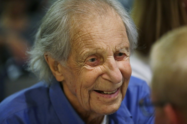 "In this photo taken July 26, 2016 in Seattle, Fred Beckey, 93, the legendary mountain climber who has bagged more first ascents than any other mountaineer and wrote the definitive guidebooks to a major North American mountain range, visits with guests during a promotional event for ""Dirtbag: The Legend of Fred Beckey,"" an upcoming documentary feature film about his life in Seattle. (AP Photo/Ted S. Warren)"