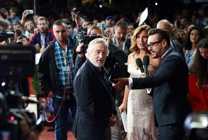 """US actor Robert De Niro, centre, stands on red carpet as he arrive for opening of the Sarajevo Film Festival in Sarajevo, Bosnia, Friday, Aug. 12, 2016. Robert De Niro opened the 22nd Sarajevo Film Festival on Friday, presented Martin Scorsese's restored """"Taxi Driver"""" and received the festival's first lifetime achievement award """"The Heart of Sarajevo. (AP Photo)"""