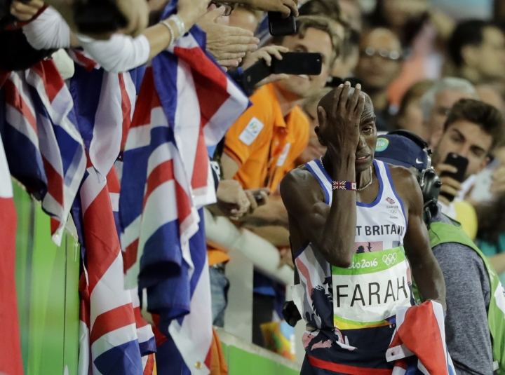 Britain's Mo Farah wipes his eye after winning the men's 10,000-meter final during the athletics competitions of the 2016 Summer Olympics at the Olympic stadium in Rio de Janeiro, Brazil, Saturday, Aug. 13, 2016. (AP Photo/Jae C. Hong)