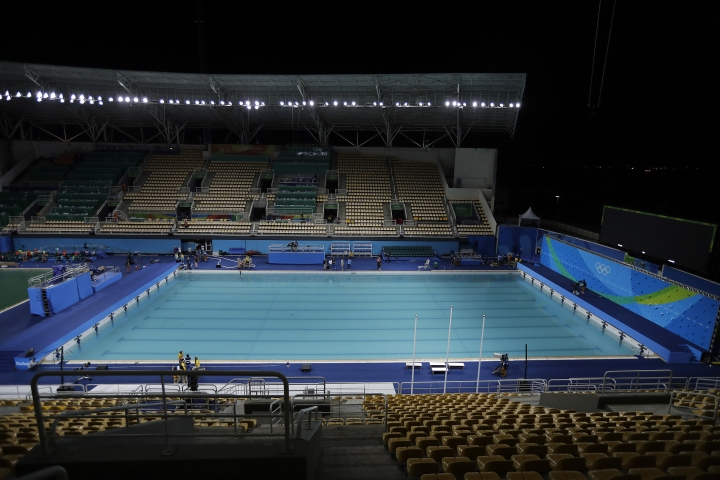 The pool in the Lenk Aquatic Center where the 2016 Summer Olympics synchronized swimming competition is photographed as the draining process starts on Saturday, Aug. 13, 2016 in Rio de Janeiro, Brazil. Olympic officials gave up on cleaning the green-tinged water in one of the pools at the Maria Lenk Aquatics Center. Instead, they began draining it Saturday and planned to transfer nearly 1 million gallons of clear water from a nearby practice pool in time for the start of synchronized swimming. (AP Photo/Wong Maye-E)