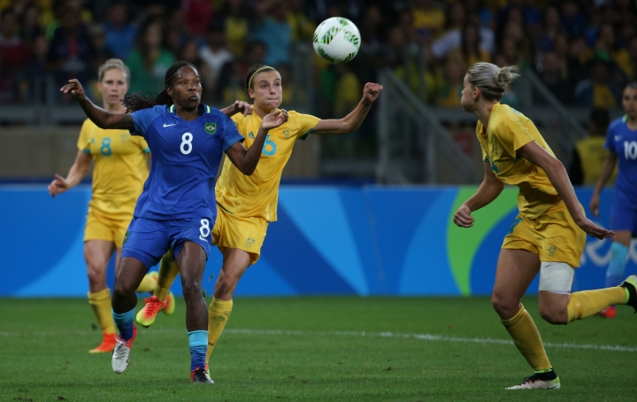 Brazil's Formiga, left, and Australia's Chloe Logarzo fight for the ball during extra time of quarter-final match of the women's Olympic football tournament between Brazil and Australia at the Mineirao Stadium in Belo Horizonte, Brazil, Saturday Aug. 13, 2016. (AP Photo/Eugenio Savio)