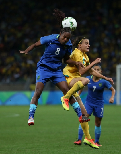 Brazil's Formiga, left, and Australia's Chloe Logarzo fight for the ball during a quarter-final match of the women's Olympic football tournament between Brazil and Australia at the Mineirao Stadium in Belo Horizonte, Brazil, Friday Aug. 12, 2016. (AP Photo/Eugenio Savio)