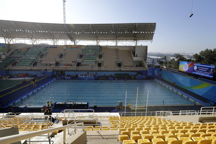 The pool in the Lenk Aquatic Center where the 2016 Summer Olympics synchronized swimming competition is held, is photographed after going through a change in water overnight, on Sunday, Aug. 14, 2016 in Rio de Janeiro, Brazil. Olympic officials gave up on cleaning the green-tinged water in one of the pools at the Maria Lenk Aquatics Center. Instead, they began draining it Saturday and planned to transfer nearly 1 million gallons of clear water from a nearby practice pool in time for the start of synchronized swimming. (AP Photo/Wong Maye-E)