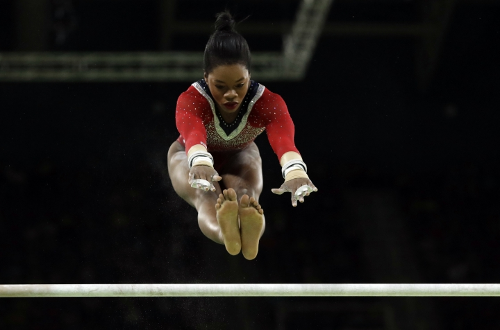 United States' Gabrielle Douglas performs on the uneven bars during the artistic gymnastics women's apparatus final at the 2016 Summer Olympics in Rio de Janeiro, Brazil, Sunday, Aug. 14, 2016. (AP Photo/Dmitri Lovetsky)