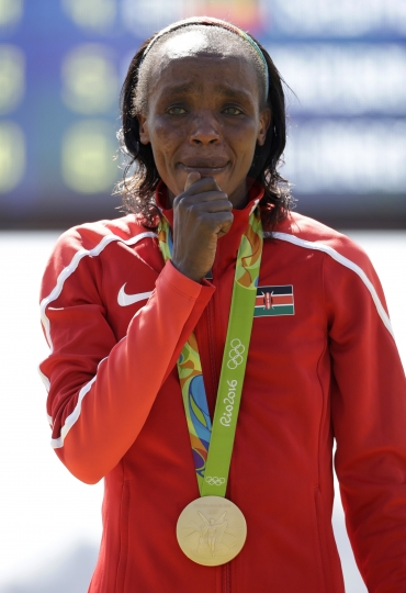Gold medalist Jemima Jelagat Sumgong, of Kenya, cries after the playing of the Kenyan national anthem following her victory in the womens marathon at the 2016 Summer Olympics in Rio de Janeiro, Brazil, Sunday, Aug. 14, 2016. (AP Photo/Robert F. Bukaty)