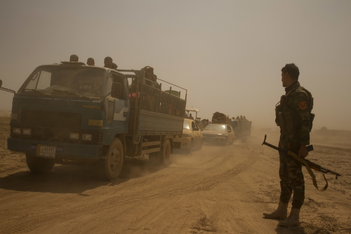 Hundreds of civilians flee villages outside Mosul the day after Iraqi Kurdish forces launch an operation east of Islamic State-held Mosul on Monday, Aug. 15, 2016. The Kurdish forces known as the Peshmerga say they have retaken 12 villages in the operation in an effort to encircle the city. (AP Photo/Susannah George)