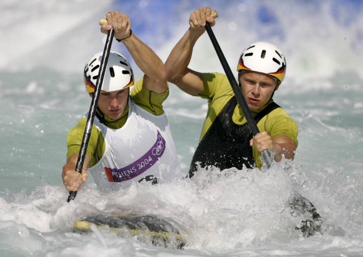 FILE - In this Aug. 19, 2004 file photo, Germany's Marcus Becker, left, and Stefan Henze, right, compete during a C2 men's canoe double category race at the Olympic Canoe-Kayak slalom venue of the Helliniko Sports Complex at the 2004 Olympic Games in Athens. The German Olympic team said Monday, Aug. 15, 2016, canoe slalom coach Henze has died from injuries sustained in a car crash last week in Rio de Janeiro. (AP Photo/Lefteris Pitarakis, File)