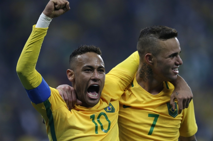 Brazil's Luan, right, celebrates with teammate Neymar after scoring his team's second goal during a quarter-final match of the men's Olympic football tournament between Brazil and Colombia in Sao Paulo, Brazil, Saturday Aug. 13, 2016. Brazil won 2-0 going through to the semi-finals.(AP Photo/Leo Correa)