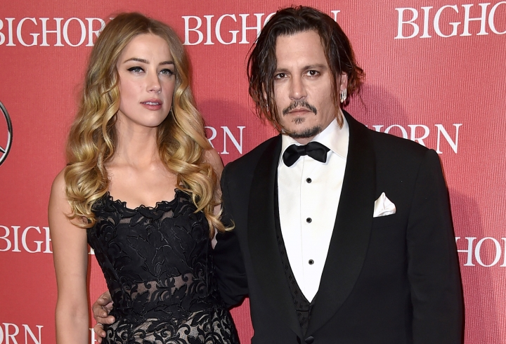 """FILE - In this Jan. 2, 2016 file photo, Amber Heard, left, and Johnny Depp arrive at the 27th annual Palm Springs International Film Festival Awards Gala in Palm Springs, Calif. Heard is withdrawing allegations that Depp physically abused her and has settled her divorce case with the Oscar-nominated actor. Heard filed for divorce in May and days later obtained a temporary restraining order accusing the """"Pirates of the Caribbean"""" star of hitting her during a fight in their Los Angeles apartment in May. Depp denied he abused her, and police said they found no evidence of a crime. (Photo by Jordan Strauss/Invision/AP, File)"""