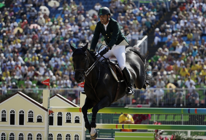 Brazil's Alvaro Doda de Miranda, riding Cornetto K, competes in the equestrian jumping competition at the 2016 Summer Olympics in Rio de Janeiro, Brazil, Tuesday, Aug. 16, 2016. (AP Photo/John Locher)