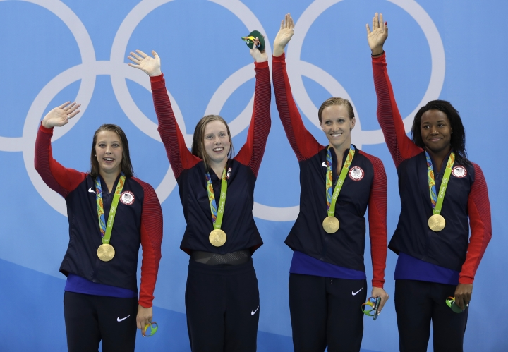 From left to right, United States' Kathleen Baker, Lilly King, Dana Vollmer and Simone Manuel wave to the audience during the medal ceremony for the women's 4 x 100-meter medley relay final during the swimming competitions at the 2016 Summer Olympics, Saturday, Aug. 13, 2016, in Rio de Janeiro, Brazil. (AP Photo/Michael Sohn)