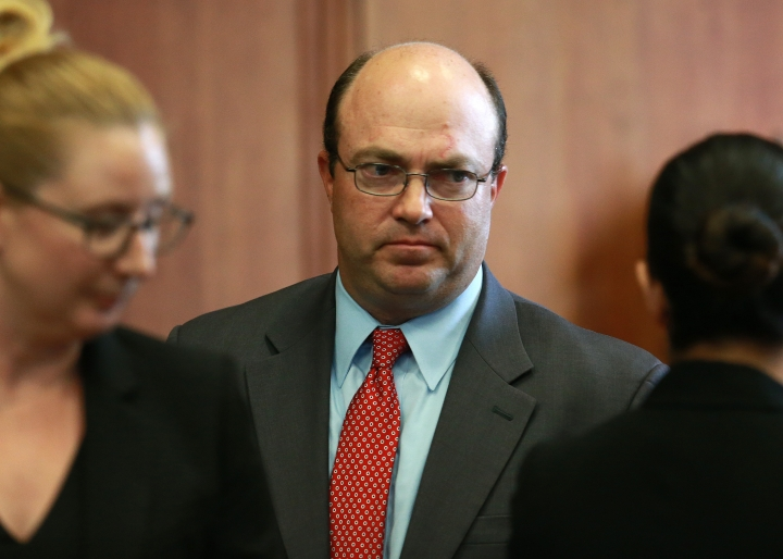 First assistant district attorney Patrick Haggan, representing the state, looks on during a pre-trial hearing for Aaron Hernandez, the former New England Patriots NFL football player, at Suffolk Superior Court, Tuesday, Aug. 16, 2016, in Boston. Judge Jeffrey Locke has set a trial date in February for Hernandez in a double murder case against him. Hernandez already is serving a life sentence for the 2013 killing of Odin Lloyd. (Matt West/The Boston Herald via AP, Pool)
