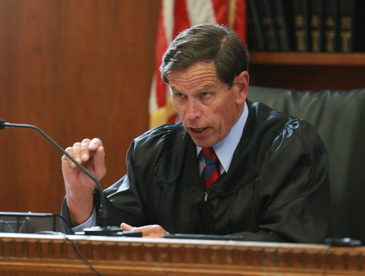 Judge Jeffrey Locke presides over a pre-trial hearing for Aaron Hernandez, the former New England Patriots NFL football player, at Suffolk Superior Court, Tuesday, Aug. 16, 2016, in Boston. Locke has set a trial date in February for Hernandez in a double murder case against him. Hernandez already is serving a life sentence for the 2013 killing of Odin Lloyd. (Matt West/The Boston Herald via AP, Pool)