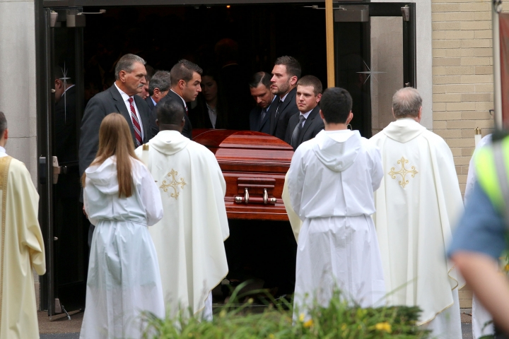 Pall Bearers carry the casket of Vanessa Marcotte ouf of Our Lady of the Lake Roman Catholic church after a funeral service Tuesday, Aug. 16, 2016, in Leominster, Mass. Marcotte, 27, who worked for Google in New York City, was killed Aug. 7 while out running near her mother's Massachusetts home. Investigators have received more than 600 tips, but no arrests have been announced. They say her male assailant may have suffered cuts, scratches and bruises from a struggle. (John Love/The Sentinel & Enterprise via AP)