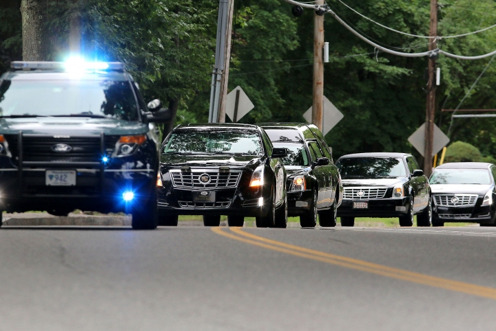 The funeral procession for Vanessa Marcotte makes its way ip Main Street , Tuesday, Aug. 16, 2016, in Leominster, Mass. Marcotte, 27, who worked for Google in New York City, was killed Aug. 7, while out running near her mother's Massachusetts home. Investigators have received more than 600 tips, but no arrests have been announced. They say her male assailant may have suffered cuts, scratches and bruises from a struggle. (John Love/The Sentinel & Enterprise via AP)