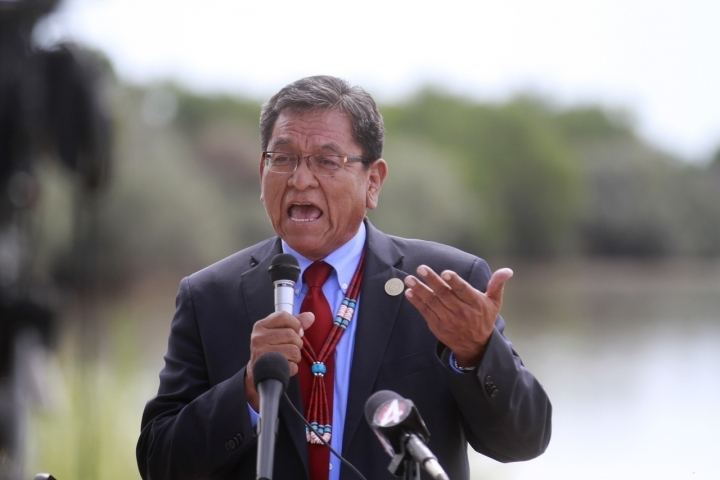 Navajo Nation President Russell Begaye speaks Tuesday, Aug. 16, 2016, at Nizhoni Park in Shiprock, N.M. Leaders of the Navajo Nation, one of the nation's largest American Indian tribes, blasted the U.S. Environmental Protection Agency as their attorneys sued Tuesday, claiming negligence in the cleanup of a massive mine waste spill that tainted rivers in three Western states. (Jon Austria/The Daily Times via AP)