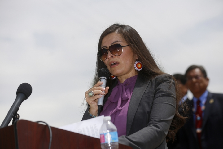 Navajo Nation Attorney General Ethel Branch speaks Tuesday, Aug. 16, 2016, at Nizhoni Park in Shiprock, N.M. Leaders of the Navajo Nation, one of the nation's largest American Indian tribes, blasted the U.S. Environmental Protection Agency as their attorneys sued Tuesday, claiming negligence in the cleanup of a massive mine waste spill that tainted rivers in three Western states. (Jon Austria/The Daily Times via AP)