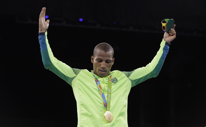 Brazil's Robson Conceicao celebrates after receiving his gold medal for the men's lightweight 60-kg final boxing at the 2016 Summer Olympics in Rio de Janeiro, Brazil, Tuesday, Aug. 16, 2016. (AP Photo/Jae C. Hong)