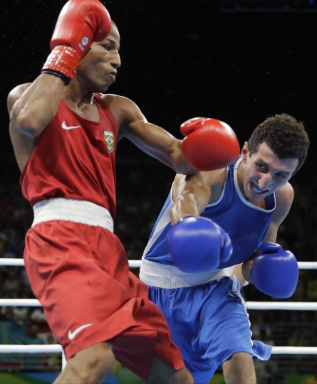 Brazil's Robson Conceicao, left, fights France's Sofiane Oumiha during a men's lightweight 60-kg final boxing match at the 2016 Summer Olympics in Rio de Janeiro, Brazil, Tuesday, Aug. 16, 2016. (AP Photo/Jae C. Hong)