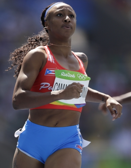 Puerto Rico's Jasmine Camacho-Quinn completes a women's 100-meter heat during the athletics competitions of the 2016 Summer Olympics at the Olympic stadium in Rio de Janeiro, Brazil, Tuesday, Aug. 16, 2016. (AP Photo/David J. Phillip )