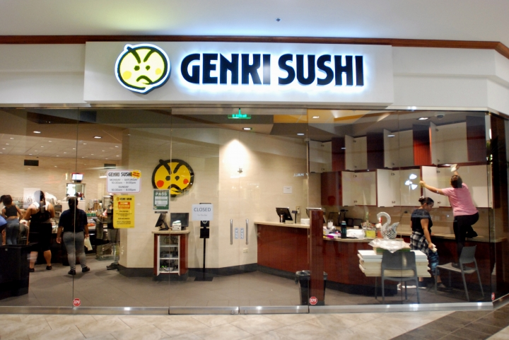 Employees clean the Genki Sushi conveyor belt restaurant chain Tuesday, Aug. 16, 2016, in Aiea, Hawaii. The Hawaii State Department of Health Sanitation said Tuesday that Genki Sushi is being ordered to close its 10 restaurants on Oahu and one on Kauai after state authorities identified its raw scallops as the probable source of a hepatitis A outbreak. The disease can cause fever, loss of appetite and other symptoms. (AP Photo/Caleb Jones)