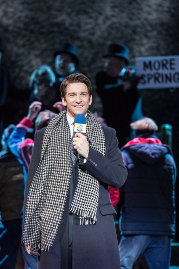 In this image provided by the Old Vic Theater in London shows Andy Karl portraying Phil Connors in the play Groundhog Day in this undated image on stage at the Old Vic Theatre in London. A musical based on the much-loved 1993 movie about a jaded weatherman forced to live the same day over and over has opened at London's Old Vic Theatre at the start of what producers hope will be a long and lucrative journey to Broadway. (Manuel Harlan/Old Vic Theater via AP)