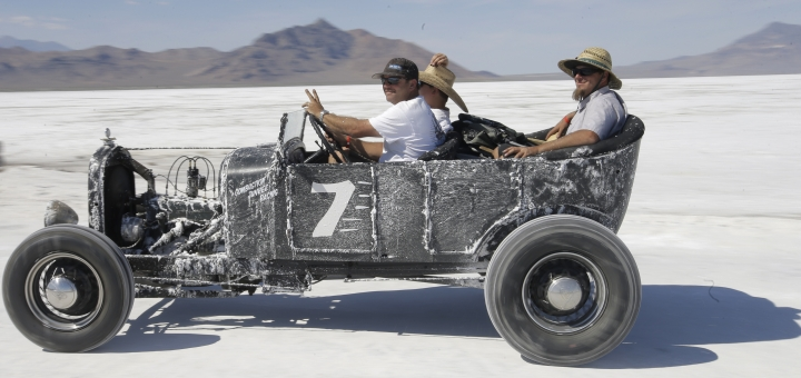 This Saturday, Aug. 13, 2016, photo, a car rides along the Bonneville Salt Flats, near Wendover, Utah. Speed-starved racers are finally back at Utah's world-famous Bonneville Salt Flats to hit speeds of 400 mph or more as they compete in Speed Week for the first time since 2013 after wet weather and rough salt cancelled the races for the last two years. (AP Photo/Rick Bowmer)