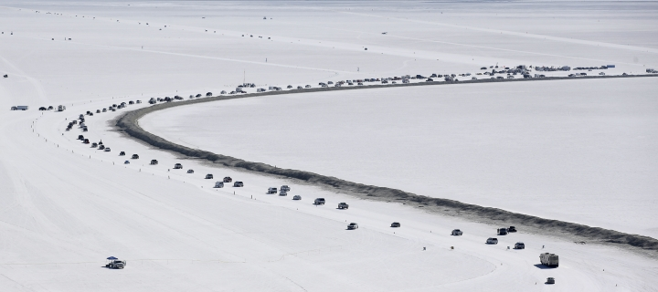 This Saturday, Aug. 13, 2016, photo, cars form a line near the race track at the Bonneville Salt Flats near Wendover, Utah. Speed-starved racers are finally back at Utah's world-famous Bonneville Salt Flats to hit speeds of 400 mph or more as they compete in Speed Week for the first time since 2013 after wet weather and rough salt cancelled the races for the last two years. (AP Photo/Rick Bowmer)